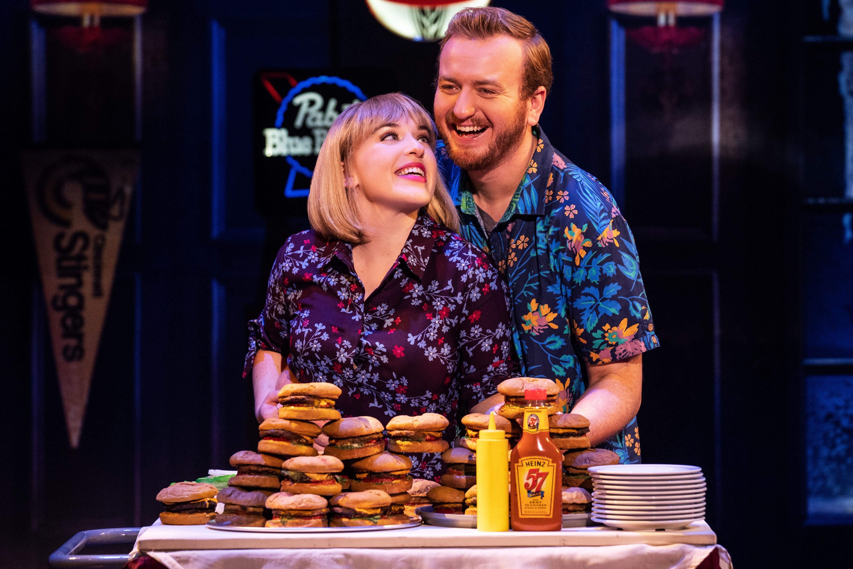 Shelly Lynn Walsh as Tammy and Peter Michael Jordan as Brick in Jimmy Buffett's ESCAPE TO MARGARITAVILLE. © Matthew Murphy
